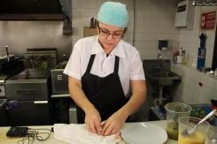 A chef prepares the tortillas.