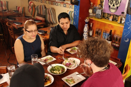 Happy customers enjoying the food at Chilam Balam.